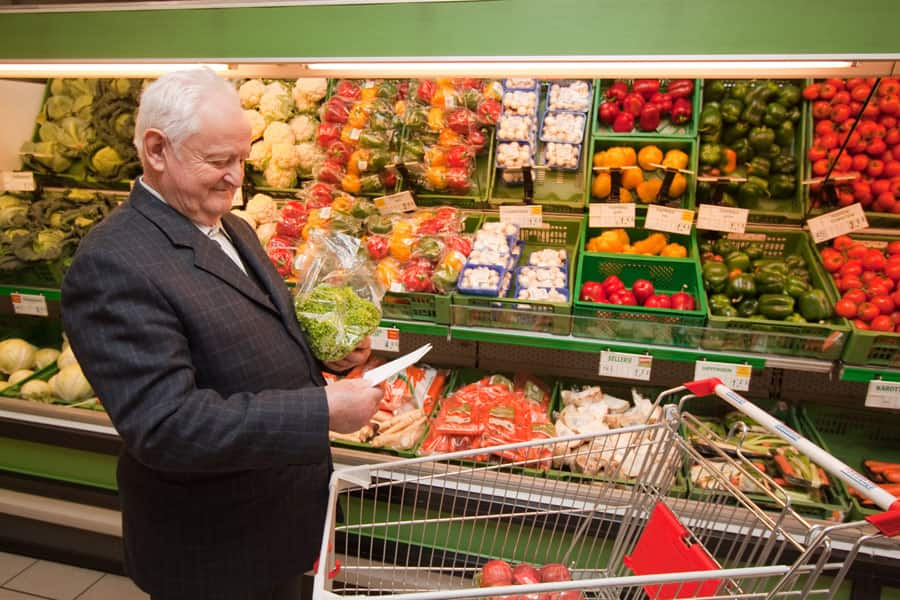 senior shopping for vegetables