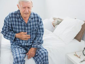 elderly in pain in bed