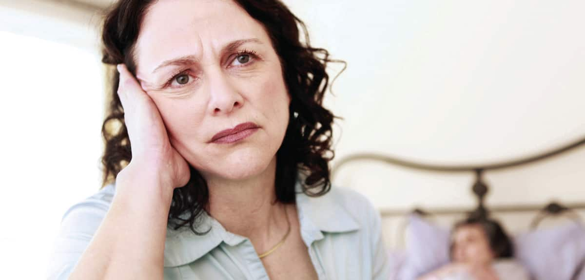 middle aged women angry with diagnosis of elderly mother